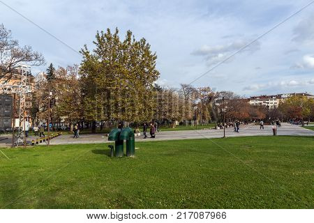 SOFIA, BULGARIA - NOVEMBER 12, 2017: Walking people on park in front of  National Palace of Culture in Sofia, Bulgaria