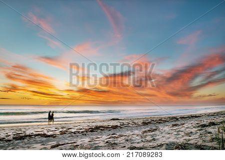 Beautiful seascape sunset over the sea with two romantic silhouette. Australia near Perth