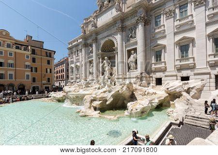 ROME, ITALY - JUNE 23, 2017: People visiting Trevi Fountain (Fontana di Trevi) in city of Rome, Italy