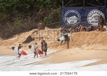 SUNSET BEACH HAWAII USA - DECEMBER 2, 2017: Competitive surfers being congratulated on the beach at the 2017 Vans World Cup of Surfing competition at Sunset Beach on Oahu's scenic North Shore. This is the second of three surfing competitions and Conner Co