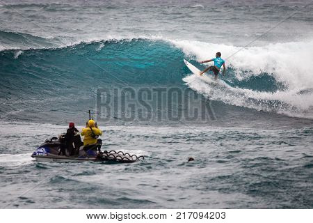 SUNSET BEACH HAWAII USA - DECEMBER 2: Surf patrol staff members filming surfers at the 2017 Vans World Cup of Surfing competition at Sunset Beach on Oahu's scenic North Shore. This is the second of three surfing competitions and Conner Coffin