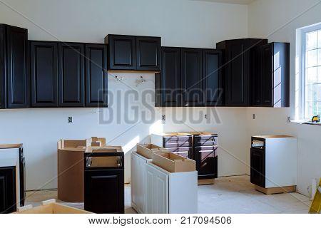 Kitchen cabinets installation Blind corner cabinet, island drawers and counter cabinets installed