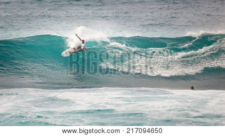 SUNSET BEACH HAWAII USA - DECEMBER 2, 2017: Competitive surfers walking on beach at the 2017 Vans World Cup of Surfing competition at Sunset Beach on Oahu's scenic North Shore. This is the second of three surfing competitions and Conner Coffin took first