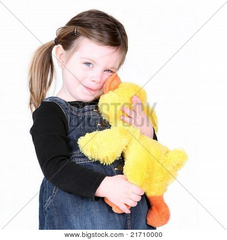 Little Girl Hugging Her Stuffed Toy On White
