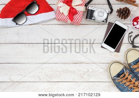 Top view aerial image of decorations & ornaments Merry Christmas & Happy New Year background concept.several accessories on modern rustic white wooden at office desk.Item for traveler to travel trip.