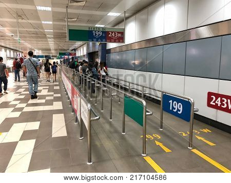 BOON LAY SINGAPORE - 29 NOV 2017: Many people waiting bus at the gate in Boon Lay bus station in Singapore