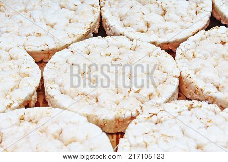 Stack of puffed whole grain crispbread. Rice cake puffed rice texture.Round rice cakes background. Corn crackers. Rice galettes Studio photo texture photography. Food.