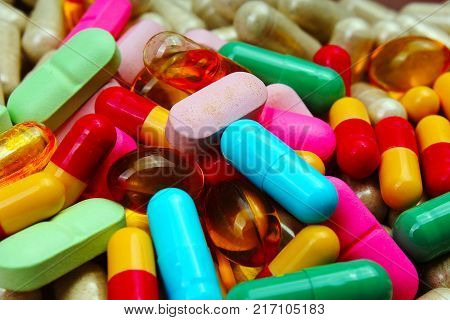 Medical or vitamin pills. Colorful medicine pills as texture. Pill pattern background. Green, red pink blue yellow.