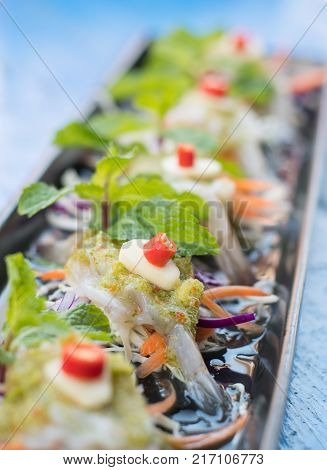Raw shrimp and spicy sauce seafood thailand (spicy salad shrimp in fish sauce)