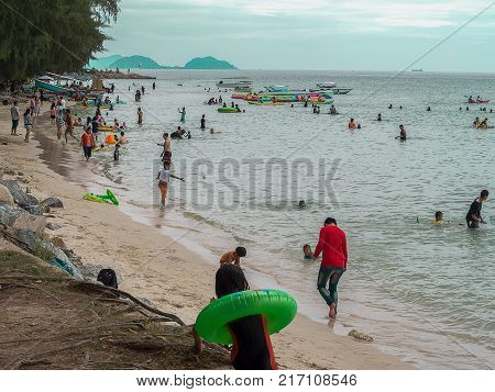 CHONBURI THAILAND - November 11 2017 View of tourists walking and playing on the beach at Nang Rum Beach (Sattahip) in Chonburi Thailand.