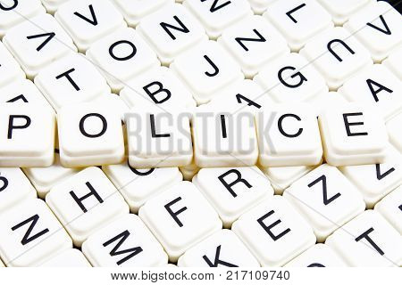 poster of Police text word crossword. Alphabet letter blocks game texture background. White alphabetical cubes blocks letters on crossword letters educational toy background. Police title.