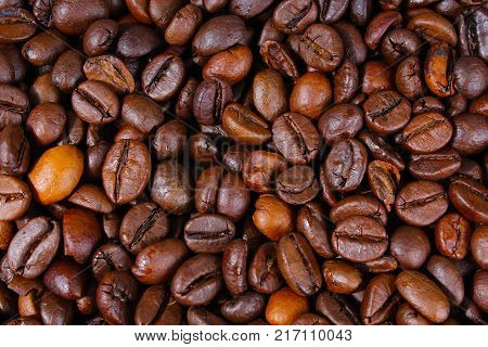 Coffee texture. Roasted coffee beans as background wallpaper. Beautiful arabica real cofee bean illustration for any concept. Gourmet coffee beans macro closeup studio photo. Coffee.