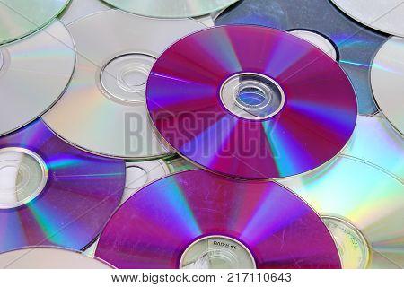 Cd, dvd reflective shiny cd dvds background texture pattern. Cds