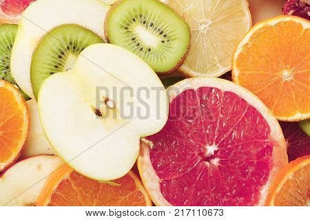 Fruit textures. Kiwi orange grapefruit lemon apple pear pomegranate mandarin fruits as background cover wallpaper. Colorful fresh fruits in rainbow colors. Beautiful delicious fruit wallpaper.