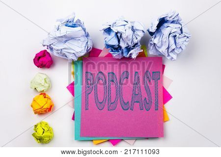 Writing text showing Podcast written on sticky note in office with screw paper balls. Business concept for Internet Broadcasting Concept on white isolated background.
