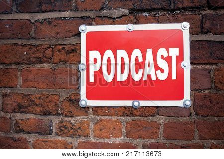 Hand writing text caption inspiration showing Podcast concept meaning Internet Broadcasting Concept written on old announcement road sign with background and space