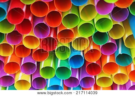 Fancy straw art background. Abstract wallpaper of colored fancy straws. Rainbow colored colorful pattern texture. Artsy wallpaper.