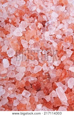Himalayan pink rose colored natural salt. Himalayan salt crystals texture pattern as background. Healthy salt from Himalayas. Rose salt.