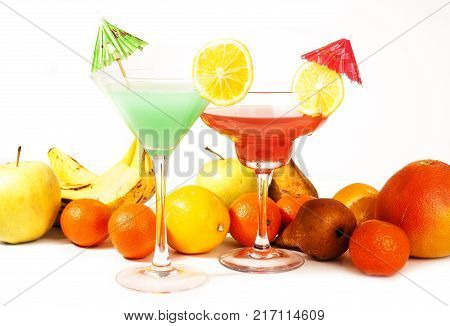 Tropical fruit cocktail concept. Cocktail with umbrella on isolated white studio background. Sexy delicious fashion drinks. Alcohol cocktails. Drink.