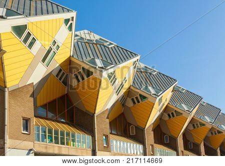 Rotterdam, The Netherlands - October 23, 2011: Yellow Cubic Houses or Kubuswoningen designed by architect Piet Blom in 1977