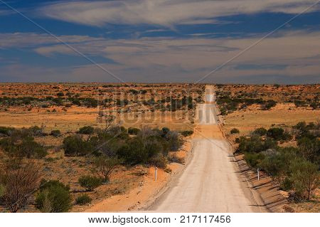 long unmade road through the Australian outback