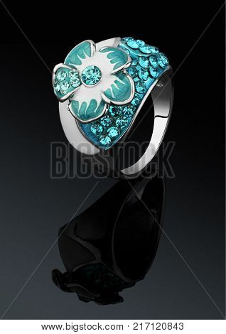 Jewelry ring on black background with reflection