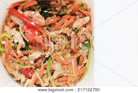 Stir-Fry Noodles with Vegetables, Asian Traditional Pasta Food Close Up Background. Rice Stir Fry Noodles Dish with Fresh Natural Bell Peppers, Carrot, Egg and Soy Sauce. Healthy Nutritious Meal.