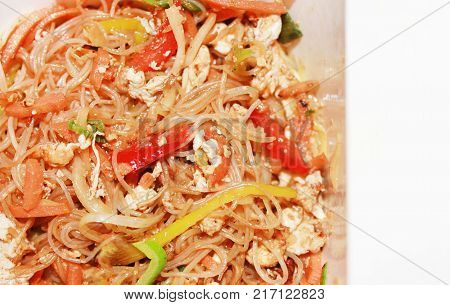 Noodle Pasta Food, Stir-Fry Asian Traditional Cuisine. Close Up of Rice Stir Fry Noodles Dish in Take Away Paper Box. Healthy Nutritious Fast Cooked Meal in Delivery Box Isolated on White Background.