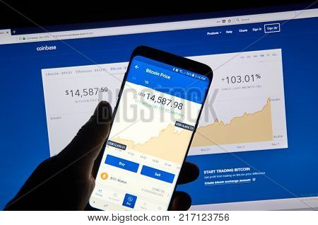 MONTREAL CANADA - DECEMBER 7 2017: Bitcoin USD price on Coinbase android app. Coinbase is a digital asset broker headquartered in San Francisco California. They broker exchanges of Bitcoin
