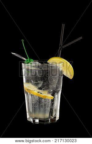 John Collins cocktail on a black background