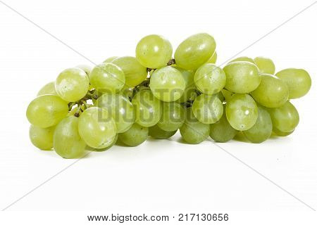 Healthy fruits Green wine grapes with isolated white background. Unwashed big wine green grapes on white background. Green grapes from a supermarket local market. Bunch of grapes ready to eat. Green.