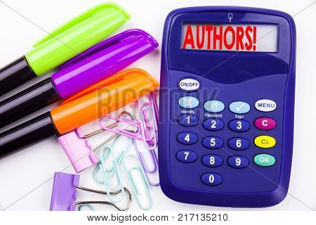 Writing word Authors text in the office with surroundings such as marker, pen writing on calculator. Business concept for Word Message Text Typography white background with space