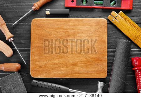 Wooden board and instruments on table
