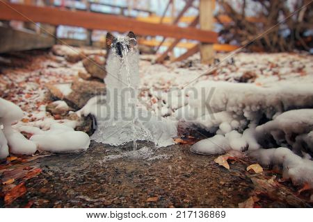Clean water flows down a beautiful stream. The photograph was taken at a silver spring, near the village of Kurma, on the shore of Lake Baikal in Siberia. Russia