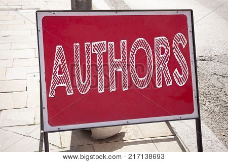 Hand writing text caption inspiration showing Authors concept meaning Word Message Text Typography written on old announcement road sign with background and space
