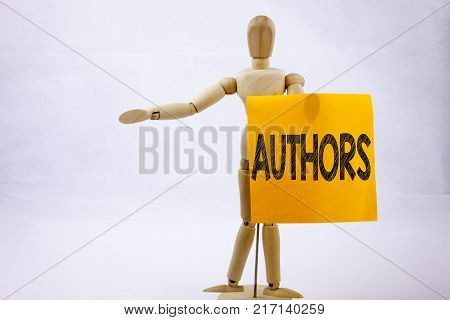 Conceptual hand writing text caption inspiration showing Authors Business concept for Word Message Text Typography on sticky note sculpture background with space