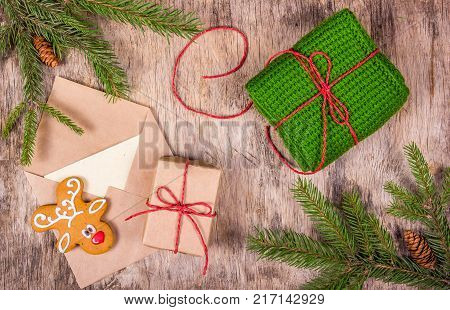 Preparation for Christmas and gift wrapping. Letter to Santa Claus. Christmas decorations with gift fir tree and gingerbread