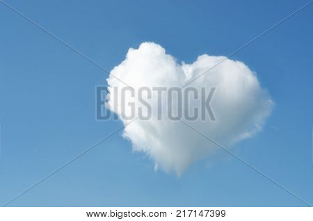 Heart Shaped White Fluffy Cloud In Bright Blue Sky