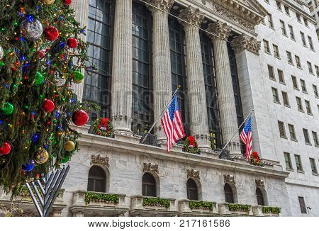 NEW YORK-DECEMBER 05: A holiday view of the New York Stock Exchange on Wall St looking past the Christmas tree on December 5 2017 in lower Manhattan.