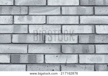 Stone texture background of grey brick wall, texture of stone bricks. Closeup of stone texture wall, made of stone grey bricks, texture stone background. Stone background, texture of stone grey brick wall