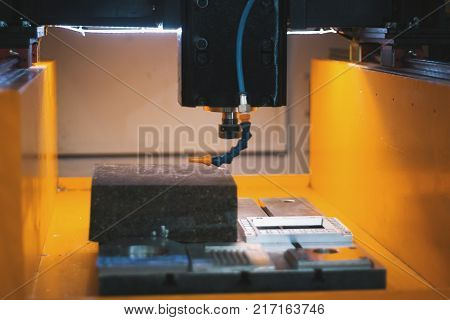 Cutting of sheet metal process in water. Sparks fly from laser by automatic cutting factory, production, close up