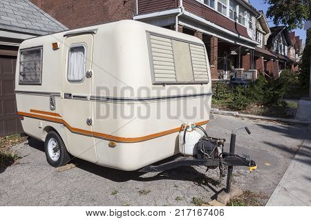 Small caravan trailer parked in the city