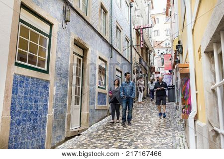 SINTRA, PORTUGAL - 03 JUNE, 2017: People walking in the Rua das Padaria in the center of the city. The area contains typical bakeries and shops.