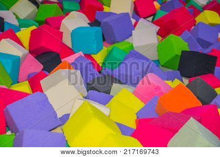 a lot of colorful foam cubes in the pool for jumping. children's trampoline club