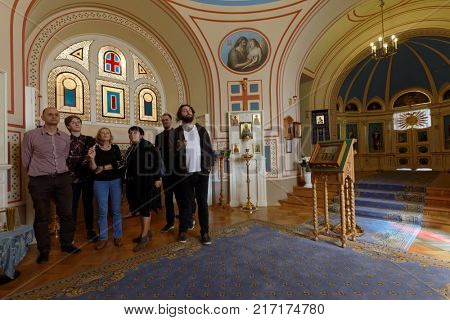 ST. PETERSBURG, RUSSIA - AUGUST 30, 2017: People in the Home Church of Yusupov palace. The palace acclaimed as the Encyclopedia of St. Petersburg aristocratic interior