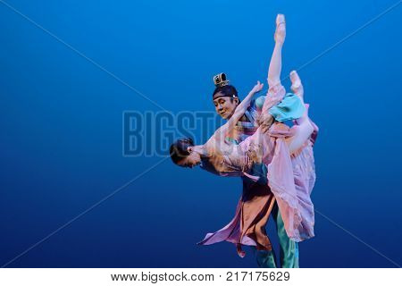 ST. PETERSBURG, RUSSIA - NOVEMBER 16, 2017: Soloists of Universal Ballet Hyemin Hwang and Jaeyong Ohm perform during gala concert of Oleg Vinogradov. Great choreographer celebrated 80th anniversary