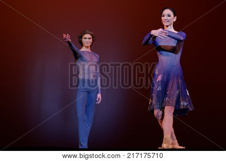 ST. PETERSBURG, RUSSIA - NOVEMBER 16, 2017: Ballet dancers Lucia Lacarra (right) and Marlon Dino after performance during gala concert of Oleg Vinogradov. Choreographer celebrated his 80th anniversary