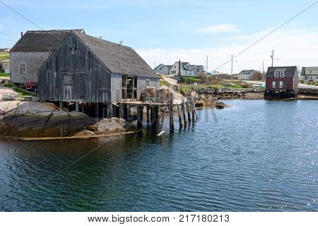 Old houses in Peggy's Cove harbour in Nova Scotia