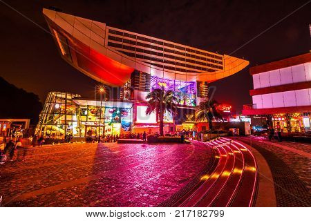 Hong Kong, China - December 7, 2016: The Peak Tower, iconic landmark, atop Victoria Peak by night. The Peak Tower is the most popular attraction in Hong Kong and the island's highest viewing platform.