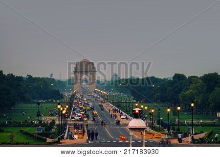 Delhi, India. Car and people traffic to the India Gate in Delhi in the evening